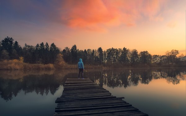 Обои lakeshore, clouds, pier, dusk, sunset, lake, trees, twilight, man, reflection